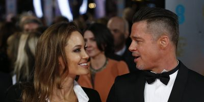 US actor Brad Pitt (R) and his wife Angelina Jolie arrive on the red carpet for the BAFTA British Academy Film Awards at the Royal Opera House in London on February 16, 2014. AFP PHOTO / ANDREW COWIE        (Photo credit should read ANDREW COWIE/AFP/Getty Images)