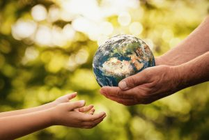 getty Senior Hands Giving Small Planet Earth To A Child
